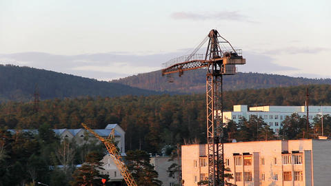 Construction site with tower crane at sunset Footage