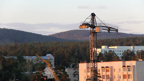 Construction site with tower crane at sunset Stock Video Footage