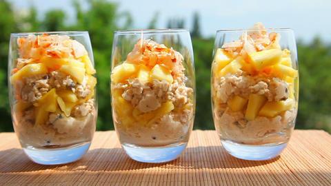 Vegan meal, pineapple muesli yogurt coconut Stock Video Footage