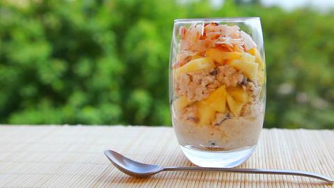 Vegan healthy food, pineapple muesli yogurt Stock Video Footage