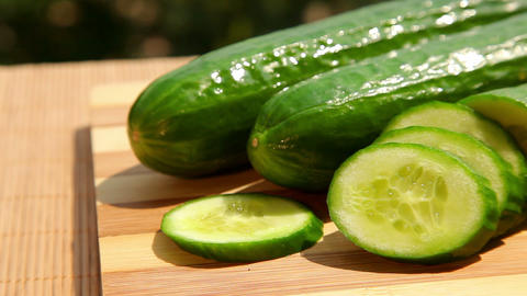 Green cucumber and cucumber slices Stock Video Footage
