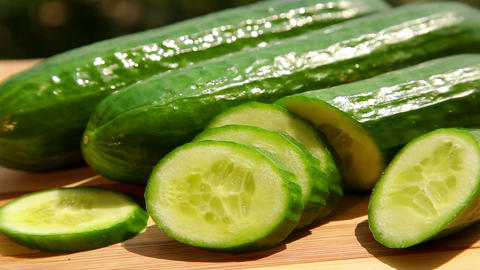 Green cucumber and cucumber slices Footage