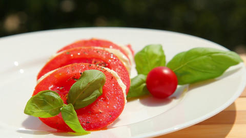 Caprese salad, slices of tomato mozzarella Footage