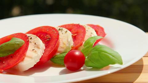 Caprese salad, slices of tomato mozzarella Stock Video Footage
