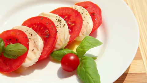 Caprese salad, slices of fresh tomato mozzarella Stock Video Footage