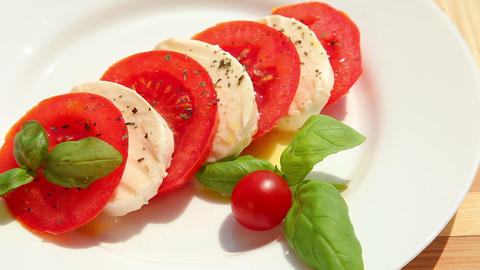 Caprese salad, slices of fresh tomato mozzarella Footage