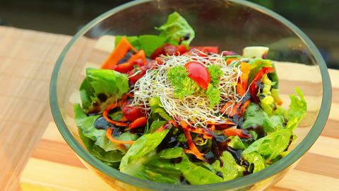 Fresh vegetable salad with dressing - dolly shot Stock Video Footage