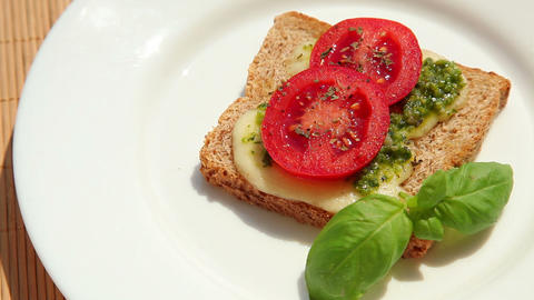 Sandwich with pesto mozzarella tomato and basil Footage