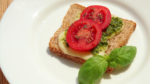 Sandwich with pesto mozzarella tomato and basil Stock Video Footage