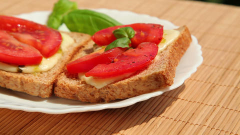 Sandwich, bread pesto mozzarella tomato and basil Stock Video Footage