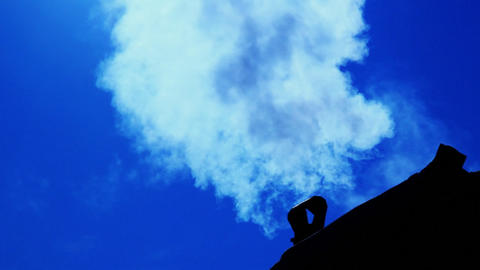 Smoking old chimney on the backdrop of clear blue Stock Video Footage