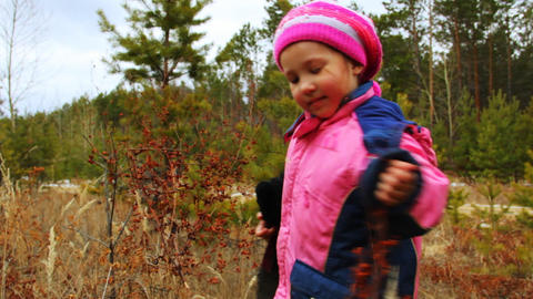 Little girl walking and playing outdoor in the aut Footage