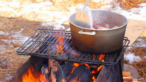 Cooking pilaf on a picnic Stock Video Footage