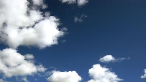 Time lapse of fast moving clouds over the blue sky Stock Video Footage