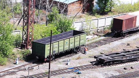 Railroad freight wagon going down on the switchyar Stock Video Footage