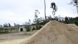 BMX biker jumping dirt jumps Footage
