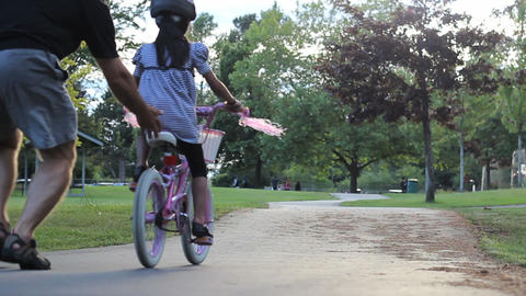 Proud Father Encourages Daughter Riding Her Bike Stock Video Footage