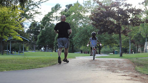 Proud Father Encourages Daughter Riding Her Bike Footage