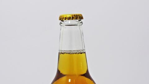 Hand opens beer bottle Stock Video Footage