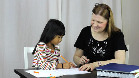 Homeschool Teacher Teaches Spelling Lesson To Daug Stock Video Footage