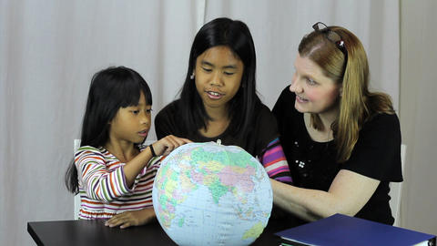 Homeschool Teacher Uses Globe To Explain Geography Stock Video Footage