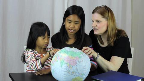 Homeschool Teacher Uses Globe To Explain Geography Stock Video Footage