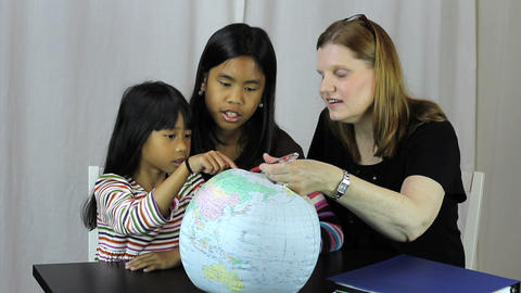 Homeschool Teacher Uses Globe To Explain Geography Footage