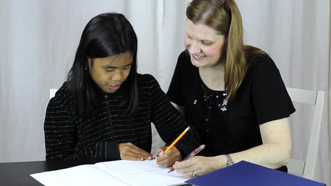 Mother Helps Asian Daughter With Homework Footage