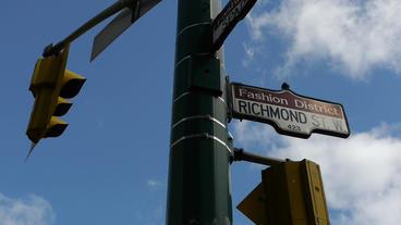 Fashion District Street Sign Traffic Light LS Stock Video Footage