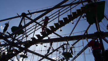 Families play on large gorilla climb ropes course Stock Video Footage