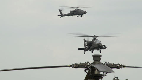 two Apache AH 64 Helicopter observing on patrol 10 Footage