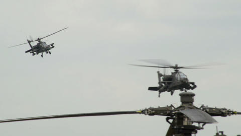 two Apache AH 64 Helicopter observing on patrol 10 Stock Video Footage