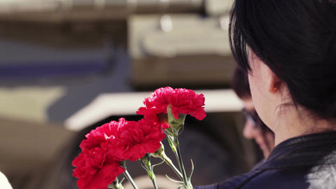Girl with carnations. Victory day celebration in Y Stock Video Footage