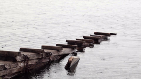 Rain drops falling on a pier at Kirillo-Belozersky Stock Video Footage