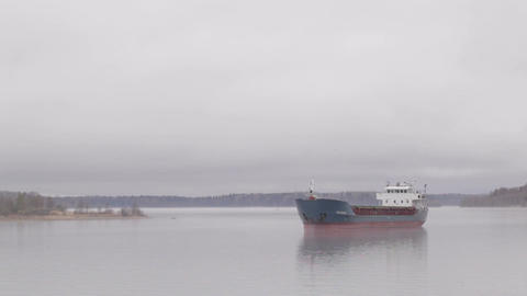 Cargo ship sailing on the Volga river in the fog Stock Video Footage