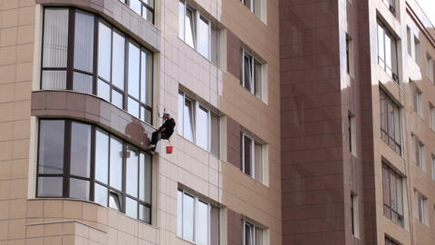Man washes the windows of office building 1 Footage