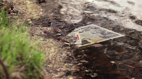 Newspaper In Water stock footage