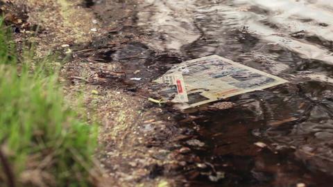 Newspaper in water Stock Video Footage