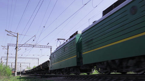 Freight train shot from low angle in the morning Footage
