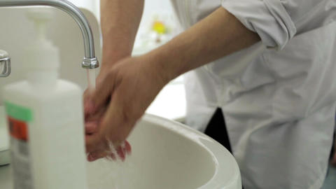 Doctor washes his hands with soap in the office Stock Video Footage
