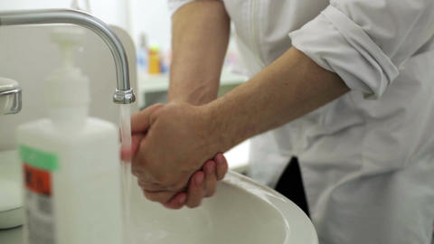 Doctor Washes His Hands With Soap In The Office stock footage