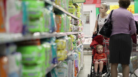 Mother with her boy in baby carriage in the superm Stock Video Footage