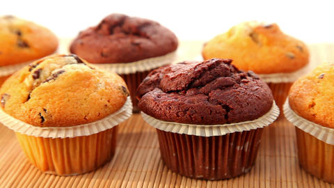 Fresh muffins with chocolate - dolly shot Stock Video Footage