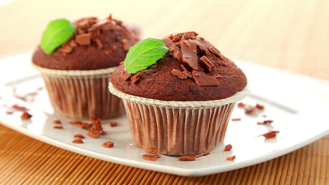 Delicious chocolate muffins with chocolate Stock Video Footage