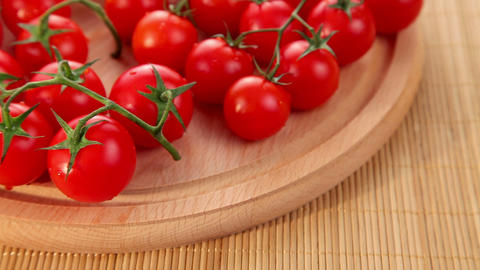 Organic fresh ripe small cherry tomatoes Stock Video Footage