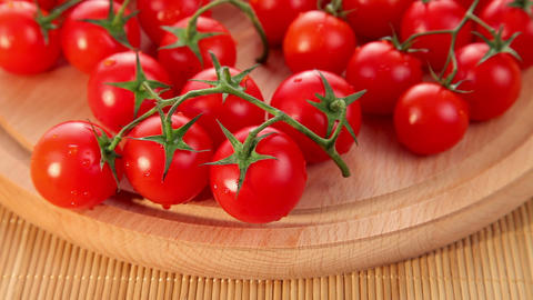 Organic fresh ripe small cherry tomatoes Footage
