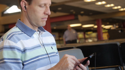 Man with MP3 Player in Airport Footage