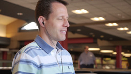 Man with MP3 Player in Airport Stock Video Footage