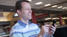 Man with Smartphone in Airport Footage