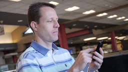 Man with Smartphone in Airport Stock Video Footage